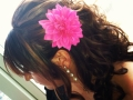bridesmaid-curly-updo-pink-flower-accessory